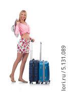 Купить «Девушка в легкой летней одежде с чемоданами отправляется в отпуск», фото № 5131089, снято 28 августа 2013 г. (c) Elnur / Фотобанк Лори