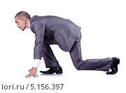 Купить «Бритый наголо молодой человек в деловом костюме в позе бегуна на низком старте. Изолировано на белом», фото № 5156397, снято 8 октября 2012 г. (c) Elnur / Фотобанк Лори