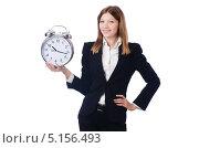 Купить «Девушка в офисном костюме держит большой будильник», фото № 5156493, снято 21 августа 2013 г. (c) Elnur / Фотобанк Лори