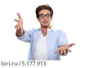 Купить «Парень в очках тянет руки к камере», фото № 5177913, снято 20 декабря 2010 г. (c) Phovoir Images / Фотобанк Лори