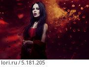 Купить «Красивая девушка вампир в красном платье», фото № 5181205, снято 15 января 2013 г. (c) Andrejs Pidjass / Фотобанк Лори
