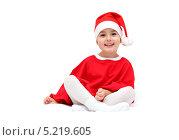 Мальчик в костюме Санта Клауса на белом фоне. Стоковое фото, фотограф Nikolay Kostochka / Фотобанк Лори