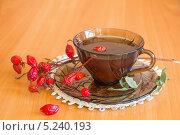 Купить «Полезный чай с шиповником в стеклянной чашке», фото № 5240193, снято 5 ноября 2013 г. (c) Дудакова / Фотобанк Лори