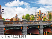 Мост через канал в центре Амстердама. Нидерланды (2013 год). Редакционное фото, фотограф Vitas / Фотобанк Лори