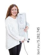 Купить «Женщина в белом свитере с обогревателем в руках на изолированном фоне», фото № 5282745, снято 17 ноября 2013 г. (c) Кекяляйнен Андрей / Фотобанк Лори