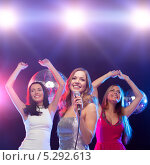 Купить «Красивые девушки отдыхают в ночном клубе под светом софитов», фото № 5292613, снято 20 октября 2013 г. (c) Syda Productions / Фотобанк Лори