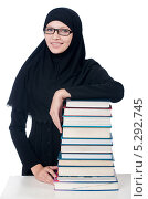 Купить «Молодая девушка в хиджабе и стопка книг», фото № 5292745, снято 26 августа 2013 г. (c) Elnur / Фотобанк Лори