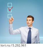 Купить «бизнесмен маркером ставит пометку в виртуальных ячейках», фото № 5292961, снято 12 сентября 2013 г. (c) Syda Productions / Фотобанк Лори