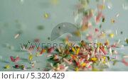 Купить «Sprinkles pouring onto blue surface», видеоролик № 5320429, снято 23 июля 2019 г. (c) Wavebreak Media / Фотобанк Лори
