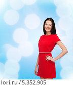 Купить «Счастливая брюнетка в красивом красном платье», фото № 5352905, снято 6 ноября 2013 г. (c) Syda Productions / Фотобанк Лори