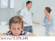 Купить «Sad boy while parents quarreling», фото № 5378249, снято 24 марта 2013 г. (c) Wavebreak Media / Фотобанк Лори