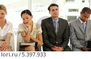 Купить «Business people waiting for an interview», видеоролик № 5397933, снято 18 июня 2019 г. (c) Wavebreak Media / Фотобанк Лори