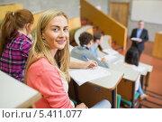 Купить «Smiling female with students and teacher at lecture hall», фото № 5411077, снято 22 августа 2013 г. (c) Wavebreak Media / Фотобанк Лори
