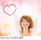 Купить «счастливая девушка в костюме ангела обняла щеки руками», фото № 5423085, снято 1 августа 2009 г. (c) Syda Productions / Фотобанк Лори