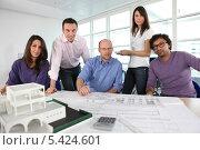 Купить «Группа сотрудников архитектурного бюро», фото № 5424601, снято 20 января 2010 г. (c) Phovoir Images / Фотобанк Лори