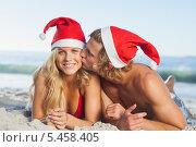 Купить «Man giving kiss to partner wearing christmas hats», фото № 5458405, снято 3 апреля 2013 г. (c) Wavebreak Media / Фотобанк Лори