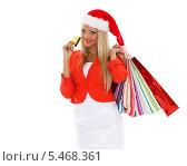 Купить «Счастливая девушка с покупками и кредитной картой стоит на белом фоне. Рождественская распродажа», фото № 5468361, снято 5 марта 2013 г. (c) Мельников Дмитрий / Фотобанк Лори