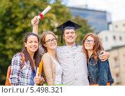 Купить «компания студентов с выпускником в академической шапочке», фото № 5498321, снято 15 сентября 2013 г. (c) Syda Productions / Фотобанк Лори