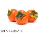 Купить «Плоды хурмы на белом фоне», фото № 5505413, снято 15 ноября 2011 г. (c) Ласточкин Евгений / Фотобанк Лори