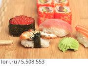 Купить «Суши и роллы. Японская кухня», эксклюзивное фото № 5508553, снято 20 января 2014 г. (c) Яна Королёва / Фотобанк Лори