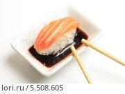 Купить «Суши с лососем, палочки и соевый соус на белом фоне», эксклюзивное фото № 5508605, снято 20 января 2014 г. (c) Яна Королёва / Фотобанк Лори