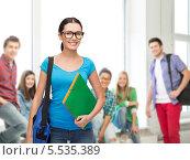Купить «улыбающаяся студентка в очках в аудитории», фото № 5535389, снято 1 декабря 2013 г. (c) Syda Productions / Фотобанк Лори