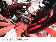 Купить «Механик диагностирует автомобиль, Rally Masters Show, Москва», фото № 5544397, снято 21 апреля 2012 г. (c) Losevsky Pavel / Фотобанк Лори