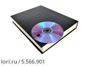 Купить «CD-диск и карта памяти на книге. Варианты хранения информации», эксклюзивное фото № 5566901, снято 8 февраля 2014 г. (c) Юрий Морозов / Фотобанк Лори