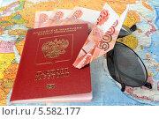 Купить «Деньги и российский загран паспорт на карте мира», фото № 5582177, снято 9 февраля 2014 г. (c) Алексей Карпов / Фотобанк Лори