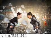 Купить «Две молодые деловые женщины скандалят», фото № 5631961, снято 18 мая 2012 г. (c) Sergey Nivens / Фотобанк Лори