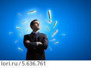 Купить «Бизнесмен среди восклицательных знаков», фото № 5636761, снято 26 апреля 2013 г. (c) Sergey Nivens / Фотобанк Лори