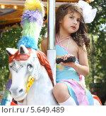 Купить «Девочка на карусели», фото № 5649489, снято 1 сентября 2010 г. (c) lanych / Фотобанк Лори