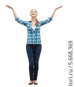 Купить «Счастливая девушка радуется, подняв вверх руки», фото № 5668369, снято 12 февраля 2014 г. (c) Syda Productions / Фотобанк Лори