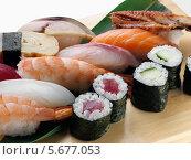 Купить «различные суши на разделочной доске», фото № 5677053, снято 7 апреля 2020 г. (c) Food And Drink Photos / Фотобанк Лори