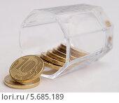 Купить «Деньги выливаются из рюмки», фото № 5685189, снято 19 января 2014 г. (c) SevenOne / Фотобанк Лори