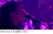 Купить «Певец с микрофоном на сцене», видеоролик № 5688713, снято 30 января 2014 г. (c) Иван Артемов / Фотобанк Лори