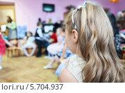 Купить «Девочка в группе детского садике, вид со спины», фото № 5704937, снято 6 марта 2014 г. (c) Кекяляйнен Андрей / Фотобанк Лори