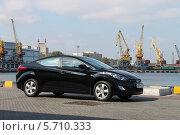 Черный автомобиль на причале в порту (2012 год). Редакционное фото, фотограф Дмитрий Романенко / Фотобанк Лори
