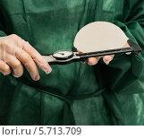 Купить «Пластический хирург измеряет штангенциркулем силиконовый протез груди», фото № 5713709, снято 9 марта 2014 г. (c) Andrejs Pidjass / Фотобанк Лори