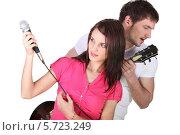 Купить «девушка м парень исполняют песню», фото № 5723249, снято 29 марта 2010 г. (c) Phovoir Images / Фотобанк Лори
