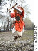 Купить «Историческая реконструкция, мужчина в одежде древнего воина с оружием в прыжке», фото № 5729517, снято 28 апреля 2013 г. (c) Losevsky Pavel / Фотобанк Лори
