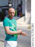 Купить «Молодой мужчина», эксклюзивное фото № 5733381, снято 13 июня 2013 г. (c) Вероника / Фотобанк Лори