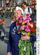 Купить «Шествие ветеранов Великой Отечественной войны по Невскому проспекту 9 Мая», фото № 5734997, снято 9 мая 2013 г. (c) Светлана Кудрина / Фотобанк Лори