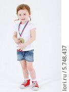Купить «Маленькая девочка стоит в шортах с медалью на груди», фото № 5748437, снято 2 февраля 2013 г. (c) Losevsky Pavel / Фотобанк Лори