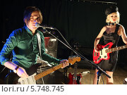 Купить «Молодой человек с гитарой поет и красивая женщина играет на гитаре в ночном клубе», фото № 5748745, снято 26 декабря 2012 г. (c) Losevsky Pavel / Фотобанк Лори