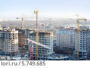 Купить «Строительная площадка с новыми многоэтажными домами и кранами», фото № 5749685, снято 23 ноября 2012 г. (c) Losevsky Pavel / Фотобанк Лори