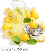 Купить «Графин лимонада и лимон на белом фоне», фото № 5750929, снято 13 марта 2014 г. (c) Ирина Денисова / Фотобанк Лори