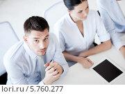 Купить «Серьезный бизнесмен на деловой встрече в офисе», фото № 5760277, снято 9 июня 2013 г. (c) Syda Productions / Фотобанк Лори