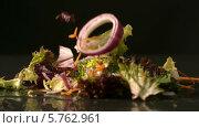 Купить «Salad falling onto black surface», видеоролик № 5762961, снято 22 августа 2019 г. (c) Wavebreak Media / Фотобанк Лори