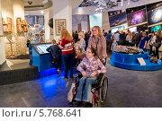 Купить «Девочка в инвалидном кресле в музее московского Планетария», эксклюзивное фото № 5768641, снято 22 марта 2014 г. (c) Володина Ольга / Фотобанк Лори